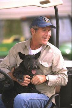 President George W. Bush sits with Barney at Prairie Chapel Ranch in Crawford, Texas. August 27, 2002.