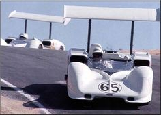 Phil Hill no.65 and Jim Hall, no.66, in Chaparral 2Es at Laguna Seca 1966. They finished 1-2 for a much deserved victory.