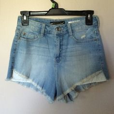 NWOT Light wash High Wasted Shorts NWOT. Brand: Lovesick. Light washed denim w/ distressed details. Front side of shorts are cut shorter than the back so pockets stick out (pic3). They pair well with a lot of the shirts we have Hot Topic Shorts Jean Shorts