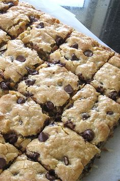 You cant eat just one of these delicious bar cookies packed with chocolate coconut and walnuts. Coconut Bars, Coconut Recipes, Baking Recipes, Cookie Recipes, Dessert Recipes, Coconut Cookies, Easy Delicious Recipes, Sweet Recipes, Delicious Desserts