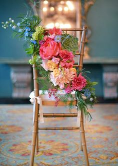 Colorful chiavari chair treatment by Lush Couture Floral. Photo by J.May Photography. #wedding https://shop.visionfurniture.com/Wood-Chiavari-Chairs_c_12.html