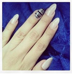 Nude almond nails with black stripes