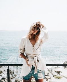 cream linen tie front top and denim shorts for women's vacation style