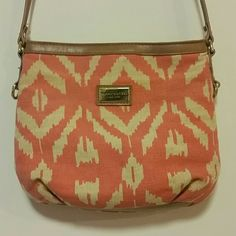 Pretty coral and taupe purse with brown leather Pretty coral and taupe Tommy Hilfiger purse with brown leather. 8 x 9.5 inches. Gently used, still very clean and in great condition! Love this bag!  Tommy Hilfiger Bags Crossbody Bags