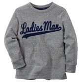 Your handsome little guy has macho style in this flocked tee.<br>