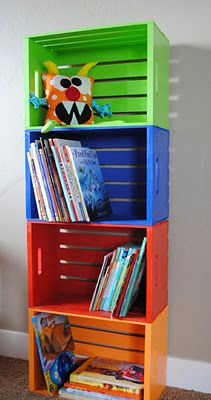 Do It Yourself Playroom Bookshelf made from crates you can get at Joann's. Paint it any color you want! (Could also do shorter for bedside table. )