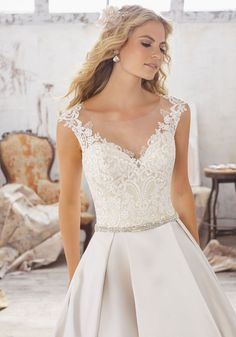 Morilee by Madeline Gardner 'Maclaine' 8103 | Beautiful A-Line Wedding Dress Features Frosted, Embroidered AppliqueŽs on Net with Duchess Satin Skirt. Crystal Beading Trims the Waistline. Covered Buttons Accent the Illusion Back. Colors Available: White, Ivory, Champagne. Shown in Champagne.