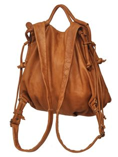 I want a hand bag/back pack like this for work, so cute. ( sadly it can't be this one way to expensive)