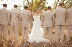cute bride pose to try with the groomsmen.