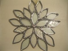 Stained glass snowflake sun catcher. Multi-textured pattern. Clear/ translucent