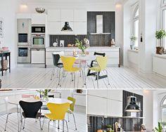 Белая кухня-столовая с черным фартуком в шведском стиле