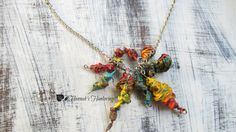 Check out this item in my Etsy shop https://www.etsy.com/listing/221897128/bohemian-rainbow-necklace-rainbow