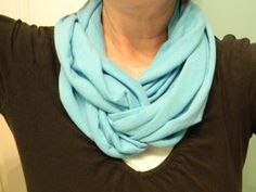 Make a scarf from t-shirt material.  Another simple no sew.  And I do love scarves.