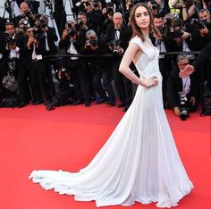 "Lily Collins on the red carpet for her film ""Okja"" at Cannes Film Festival 2017"