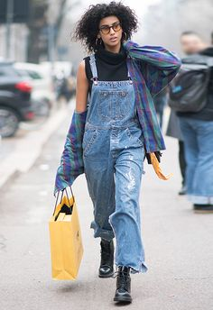 The key to casual-chic is 90s staples, so start by layering whip-on, whip-off baggy dungarees over a sleek sleeveless roll-neck. Next, add chunky leather boots, a classic chain-handle bag, plus an oversized flannel (think Nirvana vibes). Elevate the look by throwing in some glam with gold earrings and retro tinted shades. Snaps for Imaan Hammam