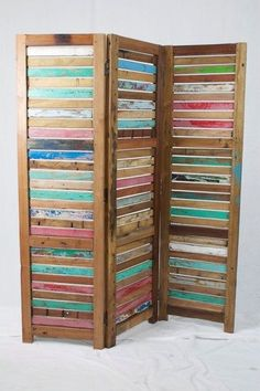 Solid reclaimed wood room divider - - it looks like this is made from old shutters, which is cool