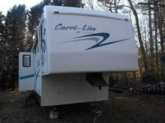 2001 Used Carriage Carri-Lite 36KS3 Fifth Wheel in North Carolina NC.Recreational Vehicle, rv, 2001 Carriage Carri-Lite 734SK3, Carriage Carri-Lite 34 Triple Slide Fifth Wheel. Very well maintained and equipped. Excellent condition virtually no road use, hitch upgrade. Manual side and Rear Patio awnings. Electric operated leveling. Interior Pickled Birch throughout. Upgraded queen bed, LCD TV, New refrigerator and hot water heater. Rear pull out sofa bed, water filter system, A/C and furnace…