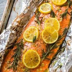 Easy Baked Salmon in Foil with Garlic, Lemon, and Herbs. One of the best simple, healthy recipes. Turns out perfectly every time! Recipes salmon Baked Salmon in Foil Baked Salmon Lemon, Oven Baked Salmon, Simple Baked Salmon, Best Simple Salmon Recipe, Grilled Salmon, Lemon Herb Salmon Recipe, Best Salmon Recipe Baked, Baked Salmon Filets, Gourmet