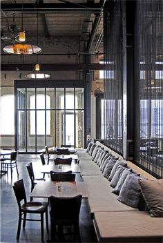 industrial style, upholstered seating, glass vestibule, Cafe restaurant Stork, Amsterdam
