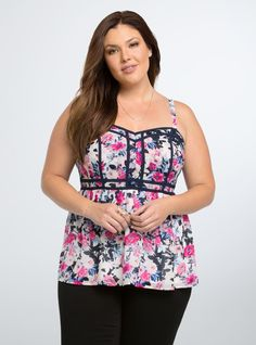 "Get used to hearing ""isn't she lovely"" in this top! The multi-color floral print flourishes while navy binding creates an eye-catching contrast! #fashion #style #spring"