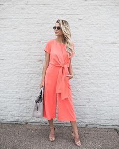 Be in the limelight in our High Profile Jumpsuit! We love this posh one piece with it's sophisticated short sleeve silhouette that ties in the front for a fitte