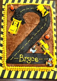 Hunters 2nd birthday cake! But no dirt, just the road and use motorcycles instead of construction trucks