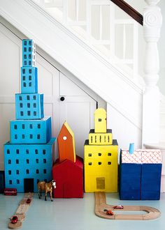 Upcycle cardboard boxes into a bright cityscape.