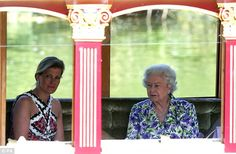 Queen Elizabeth II and The Countess of Wessex are rowed down the river Thames near Windsor