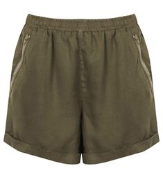 Shopping List: Fall Fashion Essentials  A pair of soft silk shorts in olive are perfect for wearing now and pair with tights and boots later.