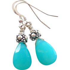 Aqua Blue Chalcedony Sterling Silver Earrings These light weight and easy to wear earrings feature beautiful permanently dyed 10x15mm aqua blue faceted Chalcedony tear drops with a sterling silver cap and hung from sterling silver ear wires. The earrings measure 1 1/2 inches in total length.