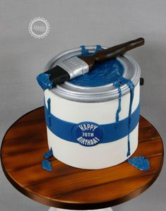 Blue Paint Bucket and paint Brush