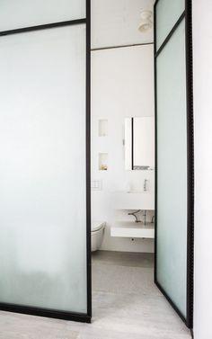 etched glass framed doors for a bathroom