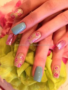 Nude and pastel nails with freehand rose nail art