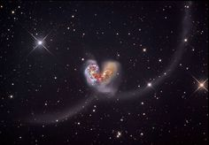 The Antennae  shows the dance of two colliding galaxies, located 60 million light years away. This event occurs in super slow motion. These galaxies have spiraled into each other for billions of years and the two merging centres are producing violent star forming regions. Matter is flung far into space in two smears of gas. Billions of years from now the two galaxies will merge to form a new galaxy.   Image Credit & Copyright: Star Shadows Remote Observatory and PROMPT/CTIO