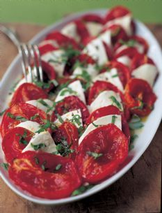 Barefoot Contessa - Recipes - Roasted Tomato Caprese Salad. I've made this several times - I've used grape or cherry tomatoes - lots of slicing but they work. So good. Can't wait till we have fresh tomatoes this summer.
