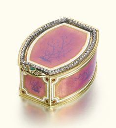 A Fabergé jewelled gold and enamel box, workmaster Michael Perchin, St Petersburg, 1895-1899. Of navette form, each surface painted with a dendritic tendril on a ground of translucent rose Pompadour enamel within opaque white line borders, the lid and base over sunburst engine-turning, the sides over reeded engine-turning and with red pellet corners, the lid with a rose-cut diamond-set frame, foliate diamond and emerald thumbpiece.