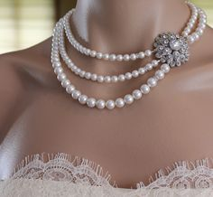 Necklace for my MOH. Handmade in Australia. Found on Etsy. All other bridesmaids had the same necklace but with only one strand of pearls and a smaller broach. Very nice way to honor my MOH as being different from the other girls.