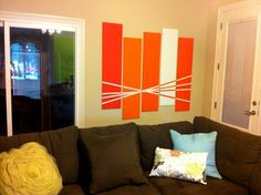 wall art  MATERIALS: mdf (12in X 48in), painters tape, paint