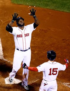 David Ortiz #34 celebrates a game-tying grand slam in the eighth inning with Dustin Pedroia #15 of the Boston Red Sox against the Detroit Tigers in Game 2 of the ALCS on 10.13.13