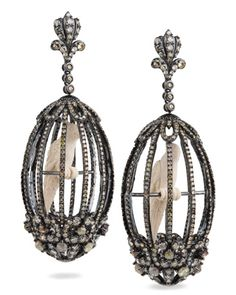 Bochic's one-of-a-kind Bird Cage earrings in 18k oxidized gold have 16.51 cts. t.w. icy rose- and single-cut diamonds and carved mammoth ivory birds; $44,700