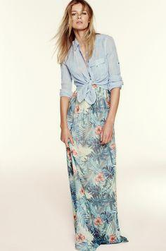 Tropical maxi dress with denim shirt.