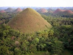 Composed of around 1,268 perfectly cone-shaped hills of about the same size spread over an area of more than 50 square kilometres (20 sq mi), this highly unusual geological formation, called Chocolate Hills, is located in Bohol, Philippines.   Read more at http://www.oddee.com/item_96619.aspx#2KqoWGKCWeMmJEBy.99