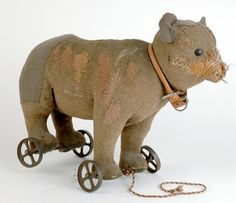 c. 1900 steiff bear on wheels