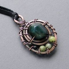 Hey, I found this really awesome Etsy listing at http://www.etsy.com/listing/126512473/copper-wire-wrapped-pendant-with-green