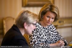 Belgian State Secretary for Poverty, Fraud and Science Elke Sleurs and Queen Mathilde of Belgium attends a presentation on poverty at the Royal Palace on April 3, 2015.