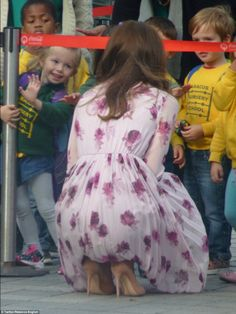 The Duchess crouches down to chat to delighted children from Balham's Abacus Nursery who h...