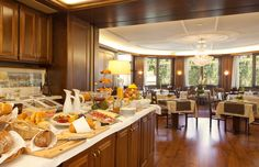 An abundant and healthy breakfast, served in a bright breakfast room with garden terrace, gives you energy and motivation for an intense working day and for an inspiring vacation time