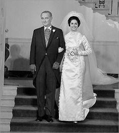 Lynda Bird Johnson, daughter of President Lyndon B. Johnson and Lady Bird Johnson, married Charles S. Robb in the White House East Room. Here President Johnson escorts his daughter towards the alter.