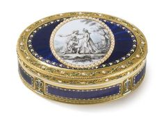 AN ENAMELED GOLD SNUFF BOX, PROBABLY SWISS, LATE 18TH CENTURY oval, the cover mounted with a grisaille miniature of lovers in a garden, surrounded by split pearls, all on translucent blue enamel ground, borders of pearl-set and enameled running leaves marked inside base and cover 20K and PG crowned incuse length 3 1/4 in. 8.2cm