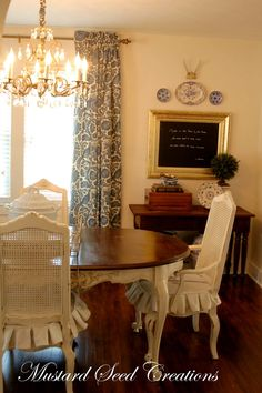 Dining Room Table and cane back chairs with custom ruffled seat covers! Add in my #Horchow Regina Andrews beaded chandelier and it's perfect!